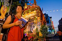 backpackers in India   SuperStock - Backpacker with guidebook in front of roadside shrine at ...