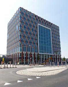 The new town hall of the city I live in: Gouda. Inspired by a typical Gouda product: treacle-waffles. Designed by soetersvaneldonk (www. Gouda, Town Hall, Sounds Like, Netherlands, Holland, Skyscraper, Waffles, Birth, Hearts
