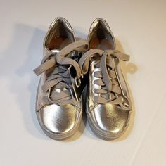50c6fb50dd9 Shop Women s Dolce Vita Silver size Sneakers at a discounted price at  Poshmark. Description  New with tags! Dolce Vita silver metallic Sammy  sneakers size ...