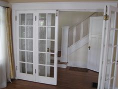Bi-fold French Doors.  Nice idea for dividing two rooms while maintaining an open floor plan