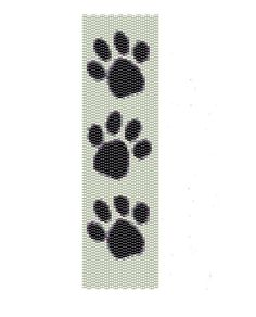 Dog Paw peyote pattern, this pattern features dog paws with black and white seed beads,  the peyote cuff are (2in x 6.57in).