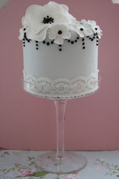 Lots of little cakes on pedestals of varying heights, each one with a coordinating design. So cute.