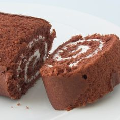 This Chocolate Buttercream Swiss Roll takes less than an hour to make. It is creamy and delicious and is great to serve when entertaining.. Swiss Chocolate Buttercream Roll Recipe from Grandmothers Kitchen.