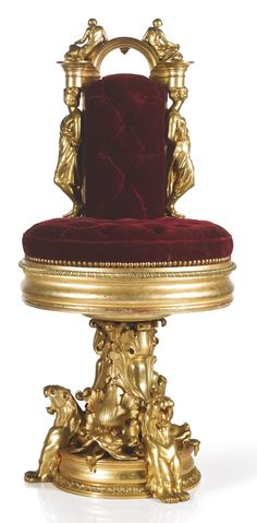 Troubadour style -   CHAIR, CIRCA 1835 -     executed in France after a design by Jean-Baptiste-Jules Klagmann -  gilt bronze, gilt wood, gilt metal, silk velvet upholstery with the coat of arms and cypher of the House of Torlonia 104 cm. (41 in.)