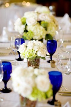 love the green and white and the pop of cobalt blue... Very fresh and refreshing