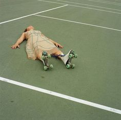 Laying on the tennis court