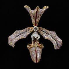 Hair ornament of gold, enamel, diamonds and rubies in the form of an orchid, made by Philippe Wolfers, Belgium, 1905-7.
