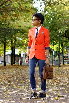 This orange blazer really pops. I also love the pattern mixing between the polka dot tie, paisley pocket square, and striped hat.   From:thechicstyler.com