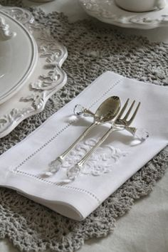 Linen ~ embroidered napkins...   And silverware with crystals!