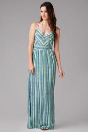 I cannot get enough of the Mantua Printed Maxi Dress. When I look at it I immediately see the ocean. I'm not much of an ocean girl, but this dress makes me want to be as near the ocean as possible, reading a book while listening the waves crash against the sand.