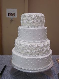 White Wedding Cakes Wedding cake---White cake with whipped icing. I can do the rosettes but not sure I could do the dots so perfectly. Buttercream Wedding Cake, Wedding Cakes With Cupcakes, White Wedding Cakes, Elegant Wedding Cakes, Elegant Cakes, Wedding Cake Designs, Wedding Cake Toppers, Buttercream Ideas, Wedding Ideas