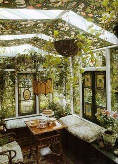 Victorian stained glass windows incorporated into a conservatory / glass house