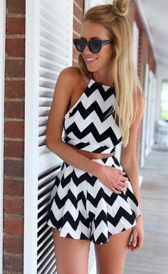 If you want to look like a dream then search no further than our black and white monochrome crop top and shorts two piece set. It features a sexy monochrome crop top with straps and a tie up cross back design. Not to mention the high waisted skirt to create an envy-inducing feminine figure.Material: Polyester and Cotton BlendsColor: White and BlackSleeve: SleevelessStyle: StrapZipper: Yes