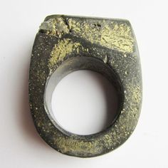 Ring | Jade Mellor. Grey resin ring with gold lustre finish and pyrite inclusions.