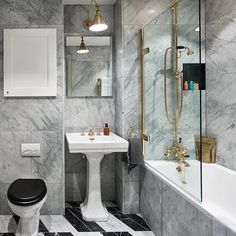 Combine Marble tiles with some of our best exclusives to make a gold statement. Shop the look of this beautiful classic #bathroom  Photo Credit - Studio London