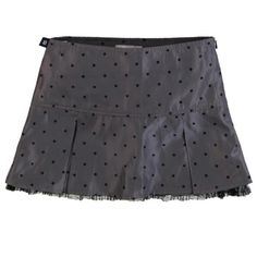 Get spot on style with a girls grey pleated polka dot skirt
