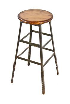 original vintage american industrial four-legged stationary machinist shop stool designed and fabricated by the pollard mfg. co., chicago, il. the c. 1940's factory stool features the a solid maple wood circular-shaped seat with stained and sealed finish. the angled iron legs are reinforced with multiple riveted joint stretchers. the leg extensions contain several pre-drilled holes for height adjustment. the original pollard green baked enameled finish remains largely intact. $295