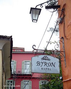 Byron Hotel sign with Grand Sarai Hotel in the background. Two of the most romantic hotel in the old part of the capital of in the - Old Town Hotels, Most Romantic, Beautiful Places, Old Things, Sign, Memories, Mansions, Travel, Greece