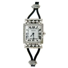 CARTIER Lady's Art Deco Platinum and Diamond Wristwatch | From a unique collection of vintage wrist watches at http://www.1stdibs.com/jewelry/watches/wrist-watches/