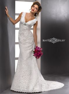 Maggie Sottero MEREDITH - 83703 on @terrycosta - Vintage lace with scalloped detail along the deep V-neckline and plunging back transforms simple style into stunning beauty in this slimming A-line featuring a Swarovski crystal brooch at the empire waist.