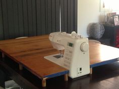 DIY: Sewing Machine Extension Table - And Sew We Craft. This is actually quite a good idea.