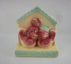 I own this & 150 more wall pockets.  Shawnee Pottery Bird Family House Wall Pocket by oldetymestore