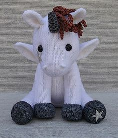 "Little Unicorn is knit in-the-round, using Magic Loop or double pointed needles. The four legs and body are all knit on as you go. Freely sitting approx. 10 ½"" tall, Little Unicorn is worked in worsted wt. (Aran/10-ply) yarn, using approx. 460 yds. Little Unicorn would make a magical gift for someone special!"