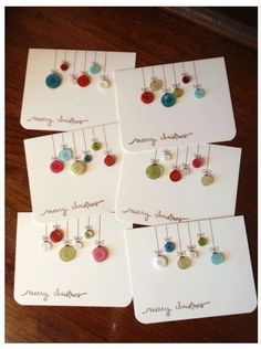 try with real buttons on woodOld buttons into ornament cards ♥Button christmas cards - so doableSouthern Fabric: 'tis the season for card giving.Handmade Christmas cards you can replicate Button Christmas Cards, Homemade Christmas Cards, Noel Christmas, Homemade Cards, Christmas Ornaments, Button Ornaments, Christmas Buttons, Hanging Ornaments, Christmas Balls