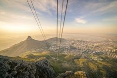 The Table Mountain Aerial Cableway hangs high amongst the clouds over Cape Town, South Africa. Visit South Africa, Table Mountain, Like Instagram, World's Most Beautiful, Lonely Planet, Cape Town, Monument Valley, Westerns, Tourism