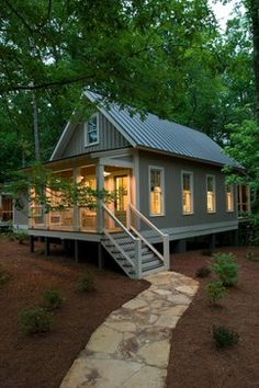 Cottage Plans and Exterior Designs for Comfortable Living: Beautiful Rustic Exterior Design Of Cottage Plans With Raised Porch Used Outdoor Staor And Wire Balustrade Also Stone Pathway Idea ~ SFXit Design Villa Inspiration Small Cottages, Cabins And Cottages, Small Cabins, Small Log Cabin, Log Cabins, Rustic Exterior, Exterior Design, Cottage Exterior, Exterior Colors