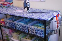 I need this ironing board fabric storage for my studio. What an awesome idea!