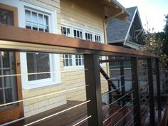 This is a very classy deck built with ipe decking and using a Hansen aluminum railing system that features stainless steel cables and an ipe top cap. This deck was designed to be free standing since the door comes off a cantilevered floor and it wa . Deck With Pergola, Pergola Ideas, Railing Ideas, Stair Railing Design, Railings, Stainless Steel Cable Railing, Ipe Decking, Dream House Exterior, Outdoor Living