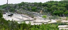 Pedernales Falls State Park. Flowing over and around huge slabs of limestone, the Pedernales River can be turbulent. But most often it is tranquil, and a great place to relax and recharge. We are just 30 miles west of Austin. Come over for an afternoon swim or hike, or load up your gear for an overnight adventure. The river awaits! RV campground: yes, 30 amp only.