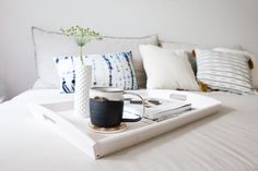 #Whynot have a daybed, complete with throw pillows, a DIY painted tray, and side tables as part of your living room design?
