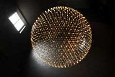 The Raimond lamp: a perfect sphere of mathematical ingredients punctuated by tiny LED lights. Looking at the lamp feels like staring into the soft glow of a starry night. Into the essence.    Raimond | Moooi.com