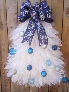 Decorate your door with this adorable Christmas Tree Wreath. It is made with white deco mesh with blue bulbs and a blue ribbon and is about 24 inches tall with the ribbon, 19 inches wide and about 5 inches deep. This wreath is perfect for the whole winter season. All my wreaths are handmade custom Christmas Tree Wreath, Christmas Decorations For The Home, Rustic Christmas, Christmas Crafts, Christmas Door, Wreaths For Front Door, Door Wreaths, Yellow Flower Photos, How To Make Wreaths