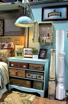 Check out the dresser filled with vintage suitcases. What a cool ideas. No drawers but plenty of storage!