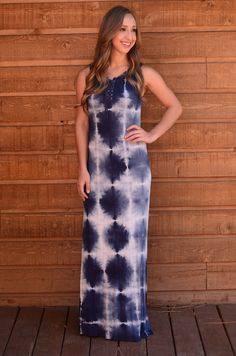 We're throwing it back to the 90's with this awesome lace up tie dye maxi dress! It's the perfect boho look with a pair of wedge heels and a brimmed hat! The material has lots of stretch and is form f