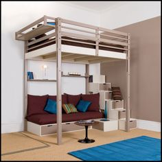 small space solution - guest bed lofted over crafting area, craft supplies inside drawer steps.