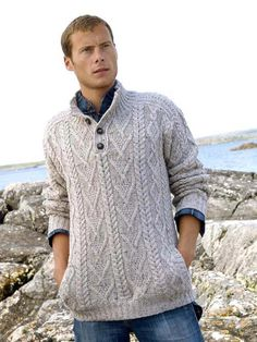 23d252eccf02 This man s button sweater is knit using Aran knitting patterns from  Ireland. This sweater features