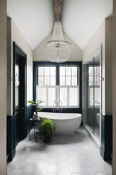 As we all know, design trends come and go. It's often tough to decipher whether a trendy bathroom update will benefit you in the long run when it comes time to resell. Luckily, the design experts at Lily Ann Cabinets are well-versed in the area of design fads. We've created this guide to let you know which 2020 bathroom trends are here to stay.  #2020Bathroom #BathroomTrends #2020BathroomDesign #BathroomInteriors Bathroom Interior Design, Home Interior, Decor Interior Design, Modern Interior, Interior Architecture, Bathroom Chandelier, Beaded Chandelier, Stand Alone Tub, Bathroom Trends