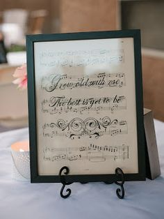 Take the music from the first dance song, break it up and use it on tables.
