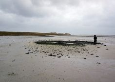 The remnants of the Bronze Age settlement at low tide at Tresness, Sanday, Orkney