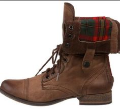Combat boots they are adorable .Everyone  is wearing them. They look really nice with a green cargo jacket and a big chunky scarf with some dark was skinny jeans.