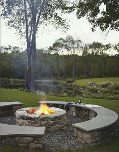 Great idea for a fire pit. Stone fireplace with stone seating. Don't have to worry about bringing lawn chairs!