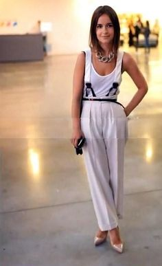 Miroslava Duma with white trousers & suspenders.
