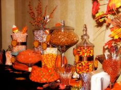 Lollipops, reeses pieces, pumpkins and candy corn, m, orange slices Ria's Classic Candy Buffets  #wedding #candy #candywarehouse