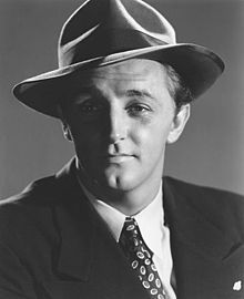 Robert Charles Durman Mitchum (August 6, 1917 – July 1, 1997) was an American film actor, author, composer and singer. He is #23 on the American Film Institute's list of the greatest male American screen legends of all time. Mitchum rose to prominence for his starring roles in several major works of the film noir style, and is considered a forerunner of the anti-heroes prevalent in film during the 1950s and 1960s.