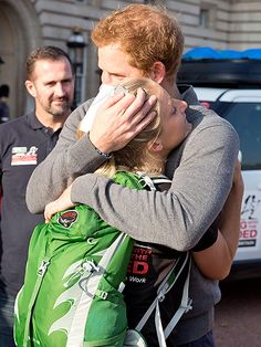 Prince Harry Hugs Marine After She Gives Him a Treasured Dog Tag. Prince Harry has his mothers compassion. He reminds me of her.