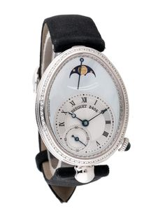 Ladies' 18K white gold 37x29mm Breguet Reine Queen de Naples automatic watch with diamond set bezel, mother of pearl and guilloche dials, metallic blue breguet hands, subdial, moonphase, cabochon embellished fluted push/pull crown, black satin strap and foldover deployment closure.